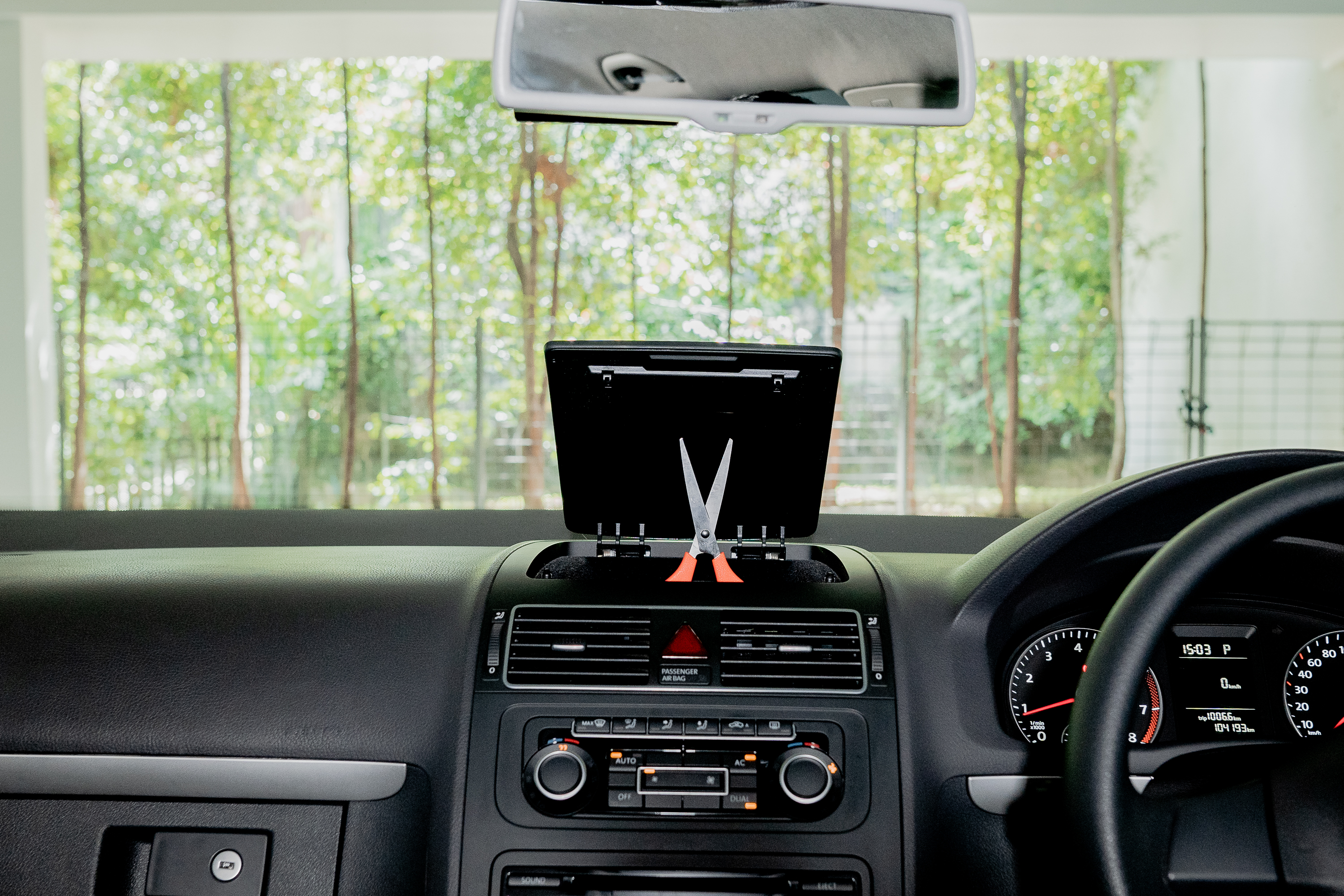 Scissor on the dashboard of your car